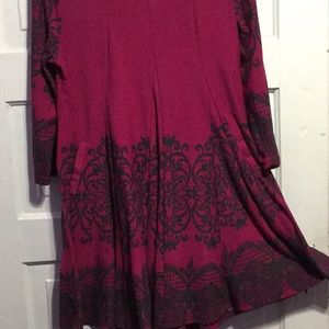 Burgundy tunic with black floral/artistic design.